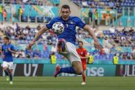Italy's Andrea Belotti reaches for the ball during the Euro 2020 soccer championship group A match between Italy and Wales, at the Rome Olympic stadium, Sunday, June 20, 2021. (AP Photo/Alessandra Tarantino, Pool via AP)