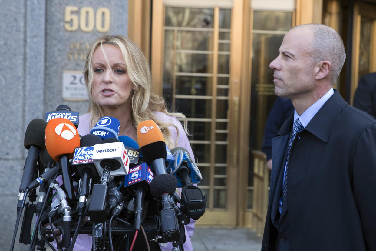 Adult film actress Stormy Daniels, left, speaks as Avenatti listens outside federal court on April 16, 2018, in New York. (Photo: Mary Altaffer/AP)