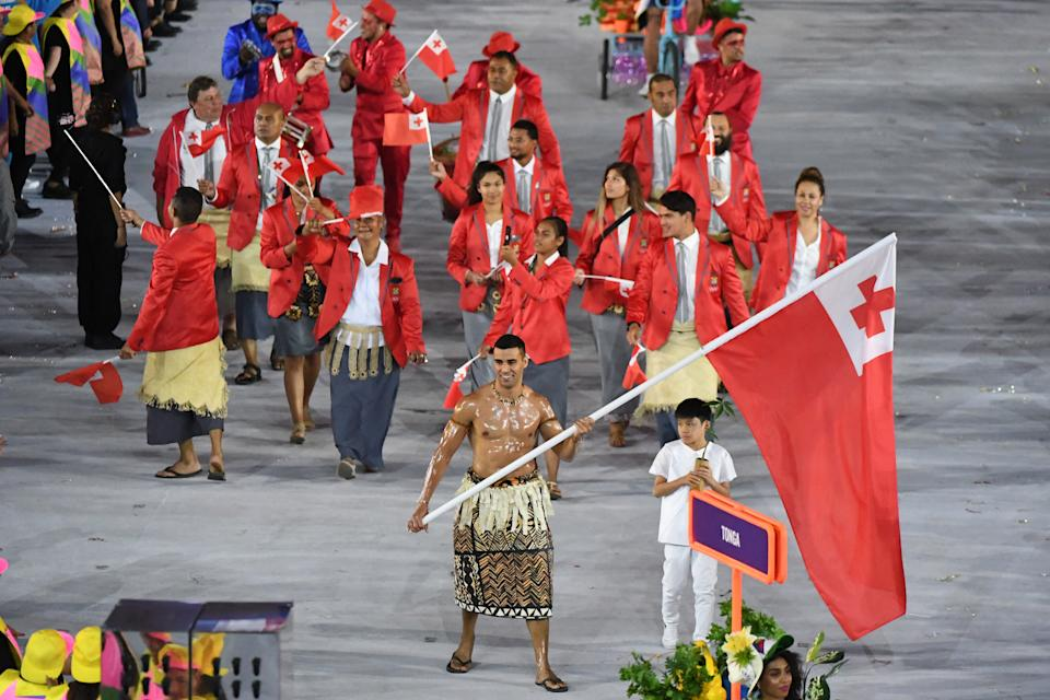 Tonga's flagbearer Pita Nikolas Taufatofua leads his delegation during the opening ceremony of the Rio 2016 Olympic Games at the Maracana stadium in Rio de Janeiro on August 5, 2016. / AFP / PEDRO UGARTE        (Photo credit should read PEDRO UGARTE/AFP via Getty Images)