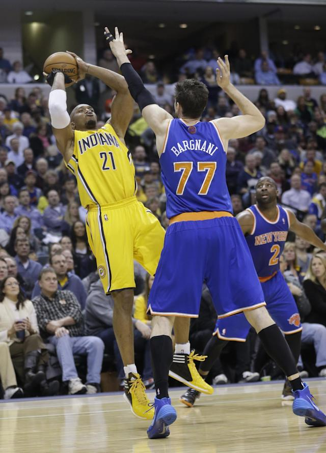 Indiana Pacers forward David West shoots over New York Knicks forward Andrea Bargnani in the second half of an NBA basketball game in Indianapolis, Thursday, Jan. 16, 2014. The Pacers defeated the Knicks 117-89. (AP Photo/Michael Conroy)