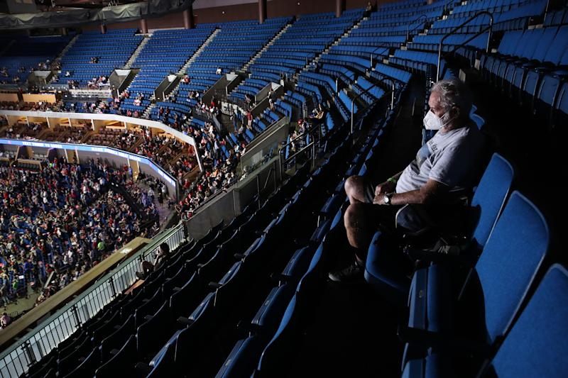 TULSA, OKLAHOMA - JUNE 20: A supporter sits in the upper seats during a campaign rally for U.S. President Donald Trump at the BOK Center, June 20, 2020 in Tulsa, Oklahoma. Trump is holding his first political rally since the start of the coronavirus pandemic at the BOK Center on Saturday while infection rates in the state of Oklahoma continue to rise. (Photo by Win McNamee/Getty Images)