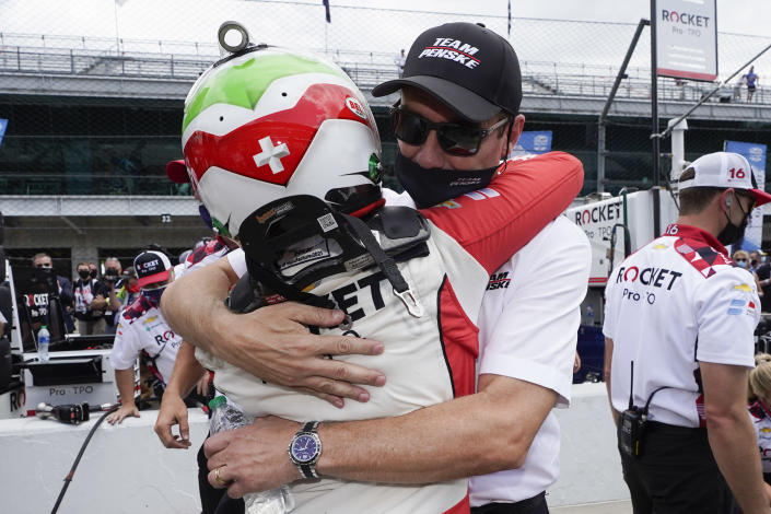 Tim Cindric, front right, hugs Simona De Silvestro, left, of Switzerland, after De Silvestro qualified for the Indianapolis 500 auto race at Indianapolis Motor Speedway, Sunday, May 23, 2021, in Indianapolis. (AP Photo/Darron Cummings)