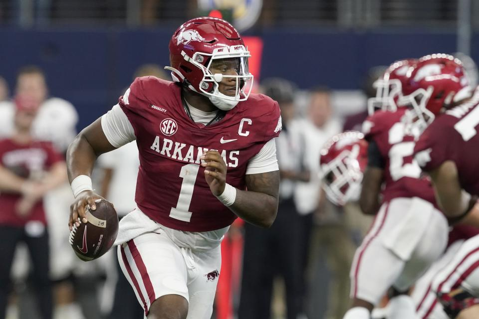 Arkansas quarterback KJ Jefferson scrambles out of the pocket before throwing a pass in the second half of an NCAA college football game against Texas A&M in Arlington, Texas, Saturday, Sept. 25, 2021. (AP Photo/Tony Gutierrez)