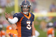 Denver Broncos quarterback Drew Lock takes part in drills at an NFL football training camp Tuesday, Aug. 3, 2021, at team headquarters in Englewood, Colo. (AP Photo/David Zalubowski)