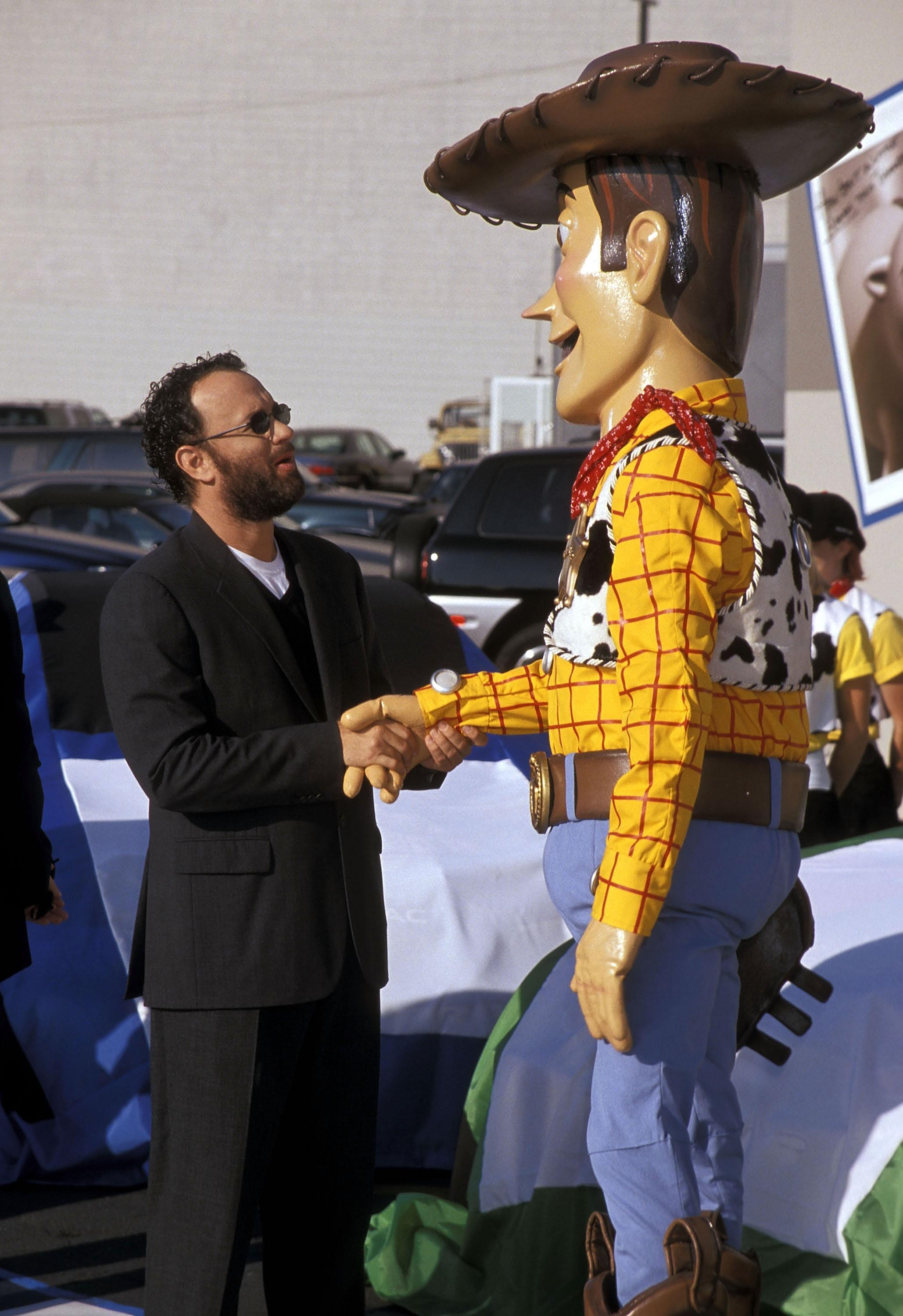 "Actor Tom Hanks and Woody attend the ""Toy Story 2"" Themed NASCAR Racing Cars Unveiling on October 23, 1999 at the El Capitan Theatre in Hollywood, California. (Photo by Ron Galella, Ltd./Ron Galella Collection via Getty Images)"