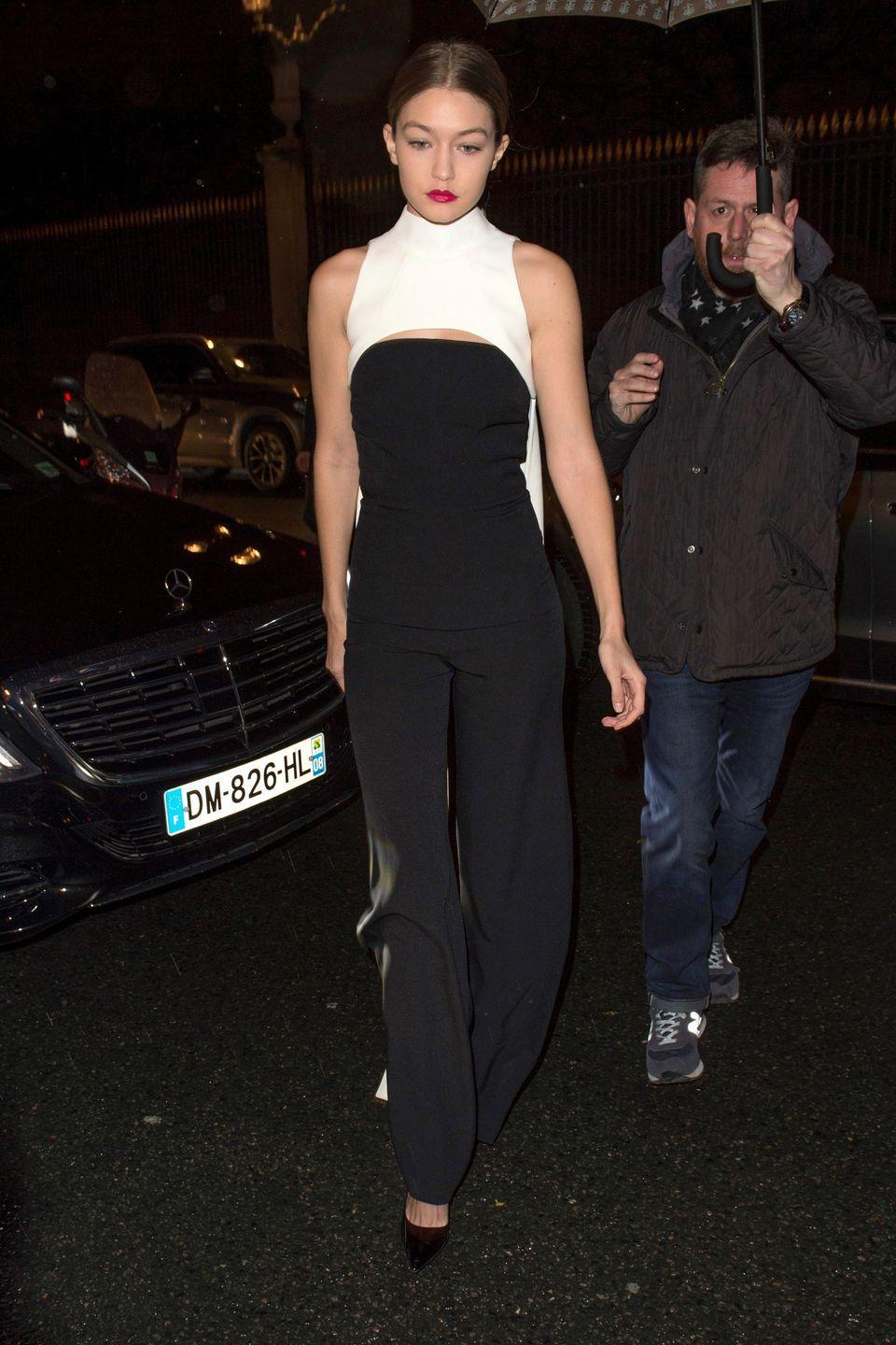 <p>At the Dior after party in a black-and-white caped jumpsuit by Safiyaa. </p>