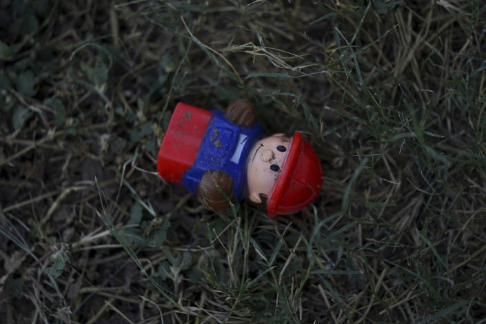 A toy covered with sand from the Rio Grande lays abandoned near the border between the cities of Del Rio, Texas, and Ciudad Acuña, Mexico, Wednesday, Sept. 22, 2021. (AP Photo/Fernando Llano)