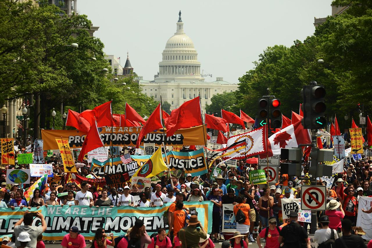 <p>People march from the U.S. Capitol to the White House for the People's Climate Movement to protest President Donald Trump's enviromental policies in Washington, DC. Demonstrators across the country are gathering to demand a clean energy economy. (Astrid Riecken/Getty Images) </p>