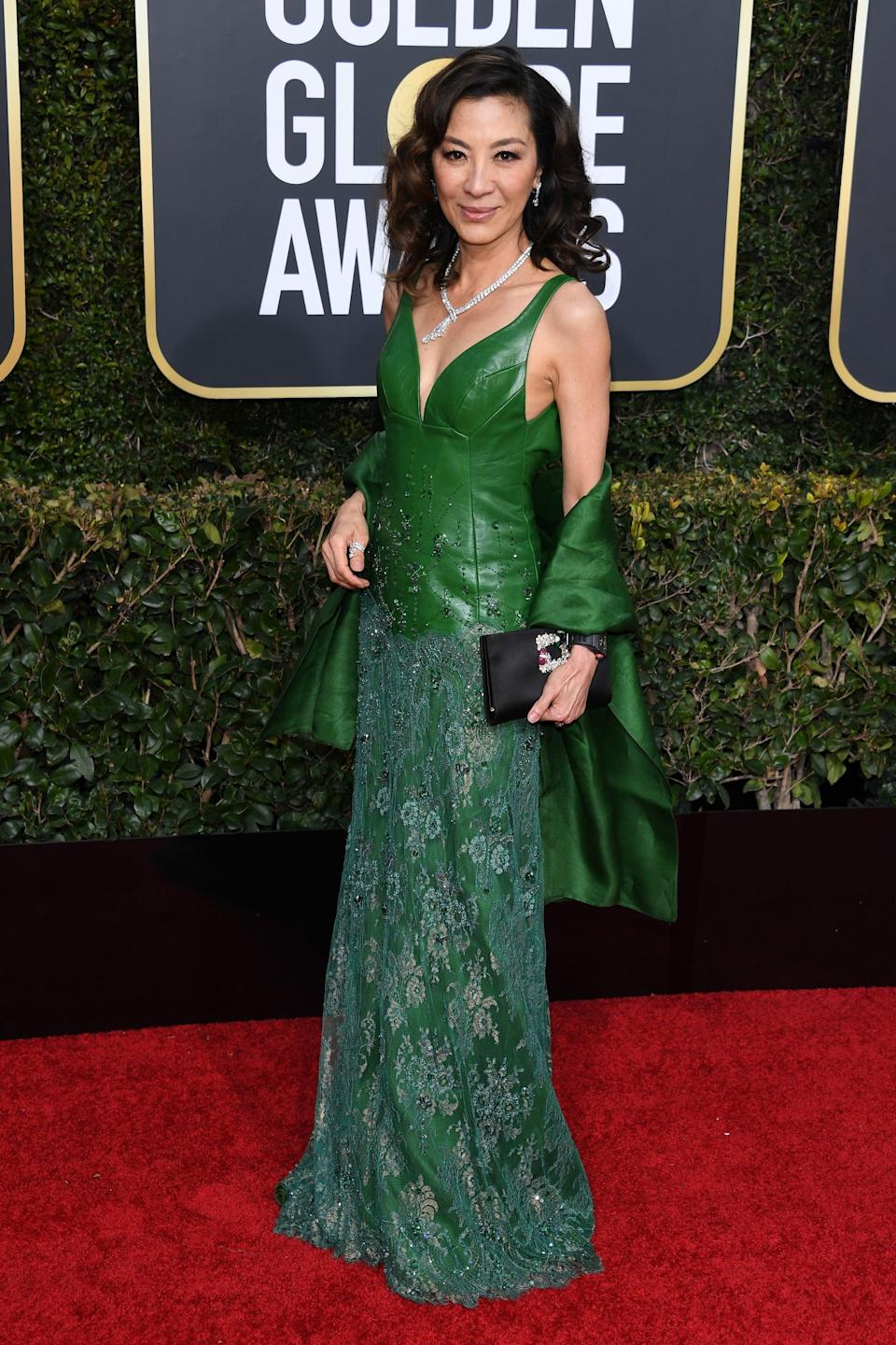 <p>Wearing an emerald gown.</p>