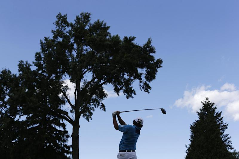 Jason Dufner watches his tee shot on the seventh hole during the final round of the PGA Championship golf tournament at Oak Hill Country Club, Sunday, Aug. 11, 2013, in Pittsford, N.Y. (AP Photo/Patrick Semansky)