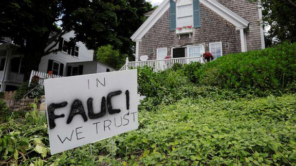 PHOTO: A sign reads 'In Fauci We Trust,' referring to the director of the National Institute of Allergy and Infectious Diseases Anthony Fauci, outside a home in Rockport, Massachusetts, July 13, 2020. (Brian Snyder/Reuters)