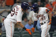 Houston Astros' Jose Altuve (27) is congratulated by Michael Brantley (23) after hitting a home run against the Los Angeles Angels during the first inning of a baseball game Wednesday, May 12, 2021, in Houston. (AP Photo/David J. Phillip)