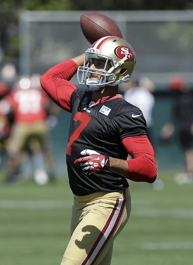 FILE - In this June 17, 2014 file photo, San Francisco 49ers quarterback Colin Kaepernick (7) passes during an NFL football minicamp in Santa Clara, Calif. Kaepernick is rich with a new contract that got done before training camp, as everybody hoped. He's ready to prove he's worth being paid among the best QBs in the league and can carry this team to a championship the way Hall of Famers Joe Montana and Steve Young did (AP Photo/Jeff Chiu, File)