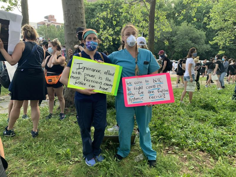 Lauren Frisk and Kassandra Rice, two nurses who traveled to New York to assist with the city's response to the coronavirus, joined protests against racial injustice Thursday in Brooklyn. (Photo by Yahoo Sports)