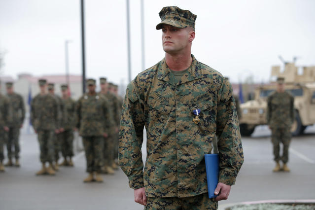 U.S. Marine Sgt. William Soutra Jr. wears the Navy Cross during a ceremony held at Camp Pendleton, Calif., Monday, Dec. 3, 2012. Soutra Jr. was awarded the medal for his heroism while serving in Afghanistan. (AP Photo/Jae C. Hong)