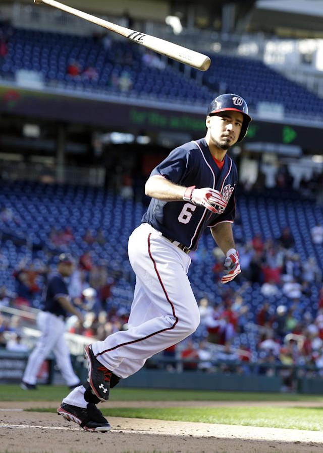 Washington Nationals' Anthony Rendon tosses his bat after drawing a walk in the ninth inning of the first baseball game of a doubleheader against the Atlanta Braves at Nationals Park Tuesday, Sept. 17, 2013, in Washington. The Nationals won 6-5. (AP Photo/Alex Brandon)