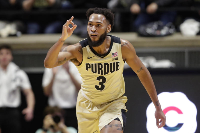 Purdue guard Jahaad Proctor (3) signals a 3-point basket against Virginia during the first half of an NCAA college basketball game in West Lafayette, Ind., Wednesday, Dec. 4, 2019. (AP Photo/Michael Conroy)
