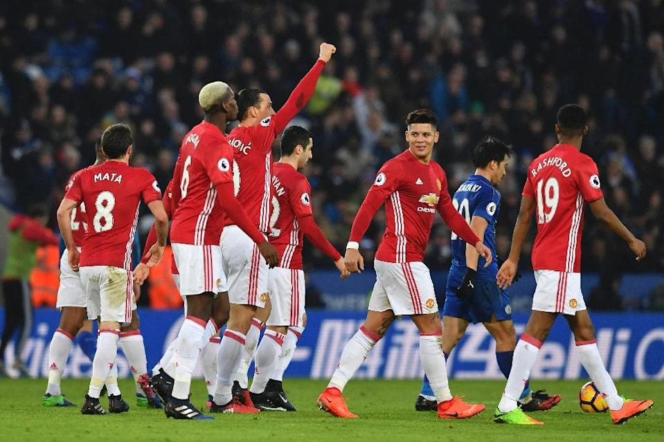 Manchester United's Swedish striker Zlatan Ibrahimovic (C) celebrates with teammates after scoring their second goal against Leicester City on February 5, 2017 (AFP Photo/Ben STANSALL)