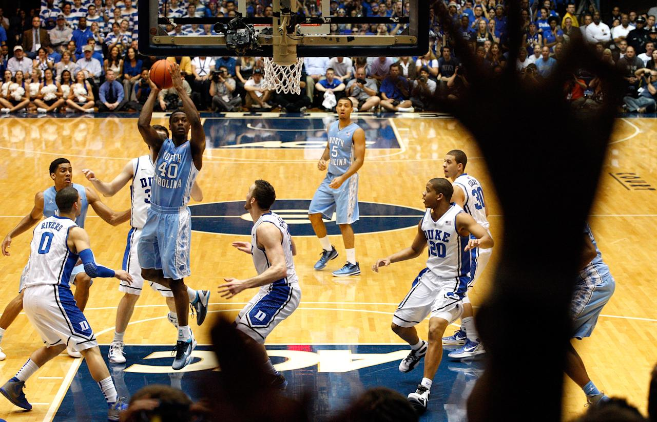 DURHAM, NC - MARCH 03:  Harrison Barnes #40 of the North Carolina Tar Heels drives to the basket on Miles Plumlee #21 of the Duke Blue Devils during their game at Cameron Indoor Stadium on March 3, 2012 in Durham, North Carolina.  (Photo by Streeter Lecka/Getty Images)