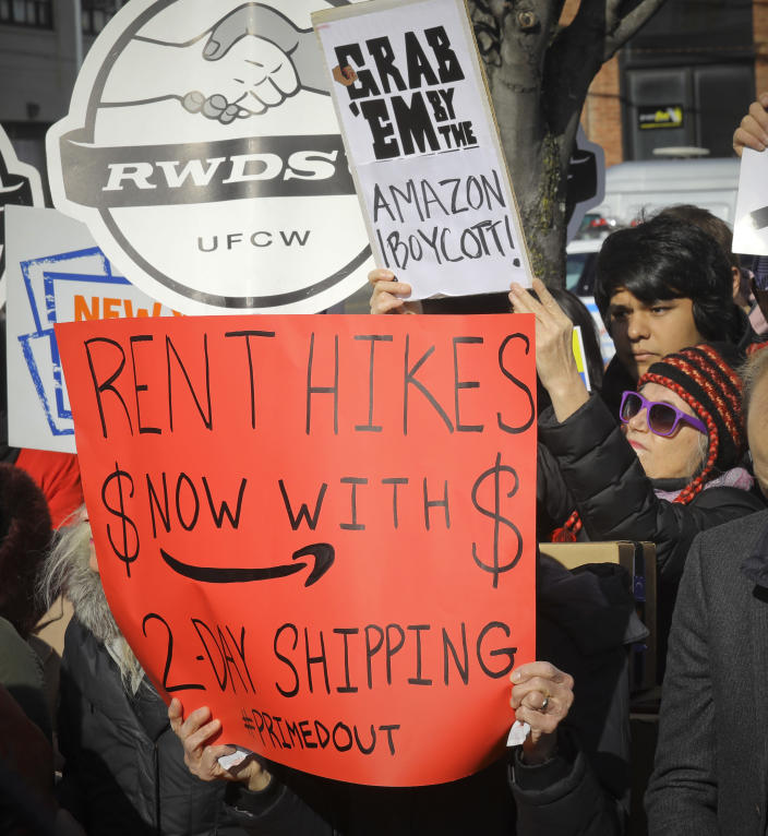 In this Nov. 14, 2018 file photo, protesters carry anti-Amazon signs during a coalition rally and press conference of elected officials, community organizations and unions opposing Amazon headquarters getting subsidies to locate in the New York neighborhood of Long Island City, the Queens borough of New York. Opposition to the retail giant coming to Long Island City by local politicians, some unions and residents of the community fearing the retail giant's presence will raise the cost of living was almost immediate. (AP Photo/Bebeto Matthews, File)