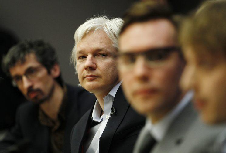 Founder of whistle-blowing website Wikileaks Julian Assange listens during a news conference alongside (L) Jean Marc Manach of OWNI and an (3L) Jacob Appelbaum an independent security expert at the City University in London December 1, 2011. (Photo: Luke MacGregor/Reuters)