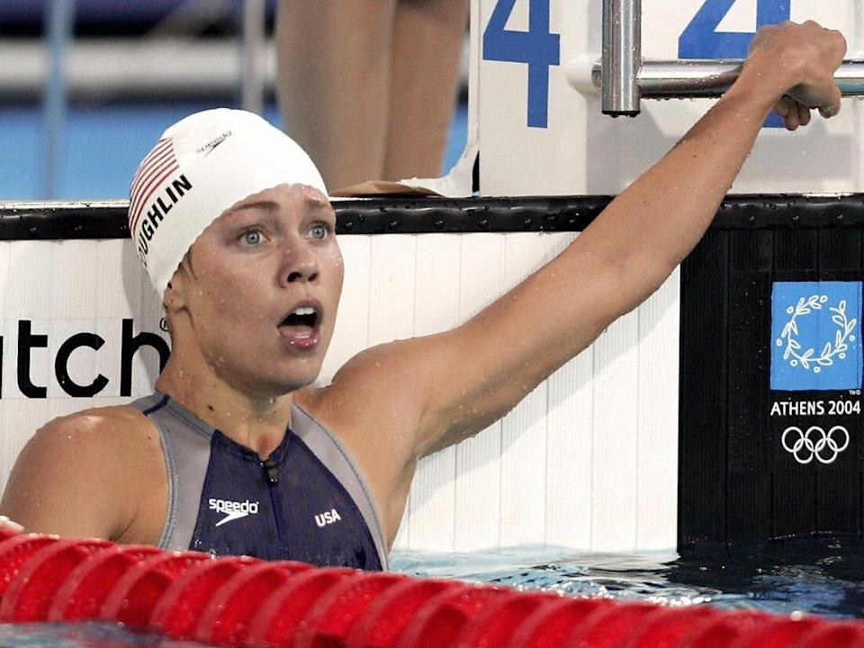 Natalie Coughlin in 2004 in the pool with a shocked face