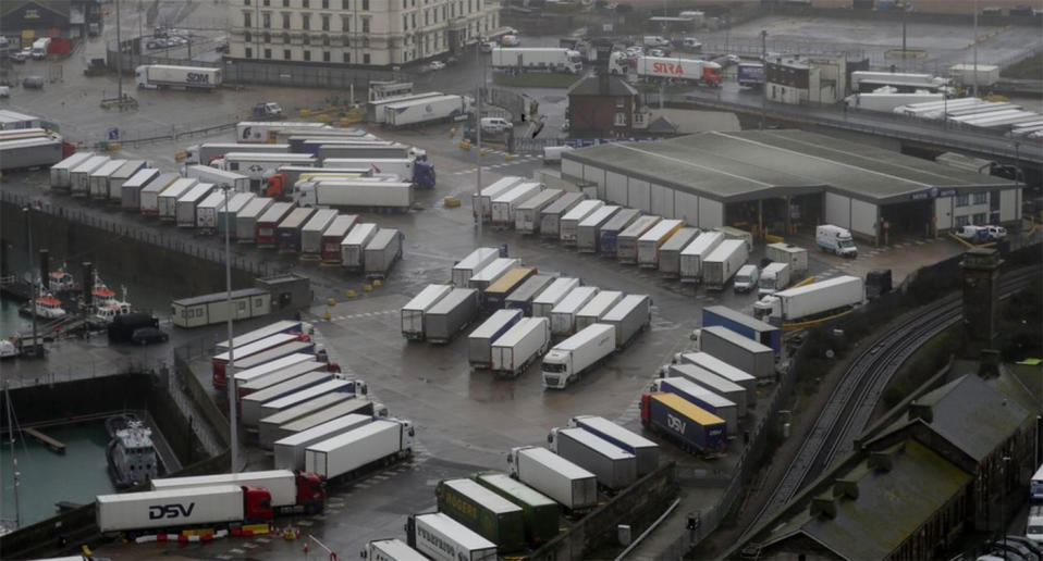 Lorries are parked near the port, Monday, Dec. 21, 2020, after the Port of Dover, England, was closed and access to the Eurotunnel terminal suspended following the French government's announcement. France banned all travel from the UK for 48 hours from midnight Sunday, including trucks carrying freight through the tunnel under the English Channel or from the port of Dover on England's south coast. (AP Photo/Kirsty Wigglesworth)