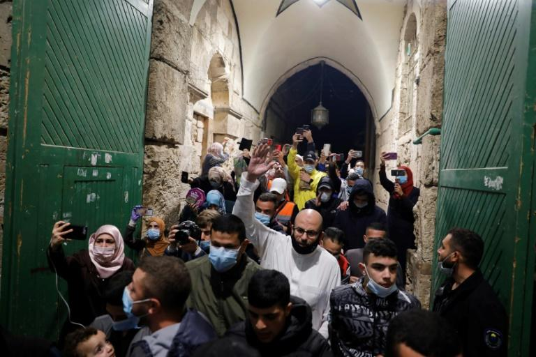 Palestinian Muslim worshippers enter the al-Aqsa mosque compound for early morning prayers