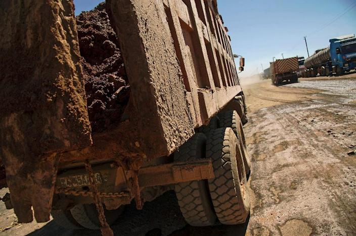 A truck carries rocks extracted from a cobalt mine near Lubumbashi. in the Democratic Republic of Congo (AFP Photo/Junior Kannah)