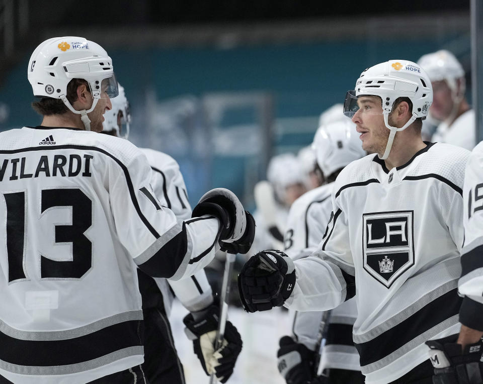 Los Angeles Kings right wing Dustin Brown, right, is congratulated by center Gabriel Vilardi (13) after scoring a goal against the San Jose Sharks during the second period of an NHL hockey game Saturday, April 10, 2021, in San Jose, Calif. (AP Photo/Tony Avelar)
