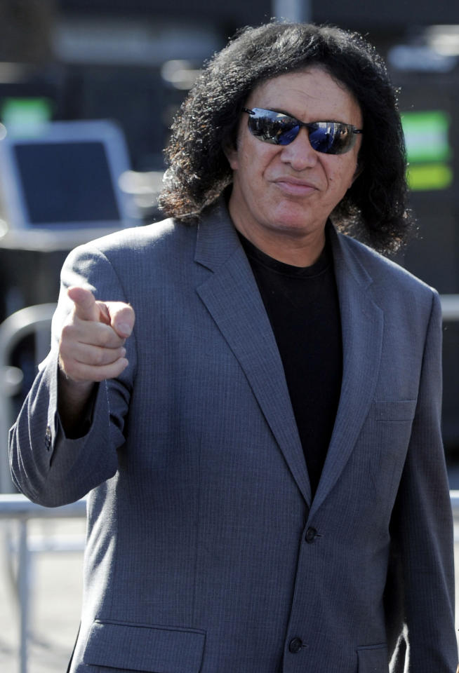 FILE - In this file photo taken Aug. 14, 2011, Gene Simmons arrives at the Do Something Awards , in Los Angeles. A Connecticut man affiliated with the Anonymous hacking group has been arrested on federal charges for an attack on a website belonging Simmons. Kevin Poe, of Manchester, Conn., made his initial appearance Tuesday in federal court in Hartford, Conn., and was released on $10,000 bond. (AP Photo/Chris Pizzello, file)