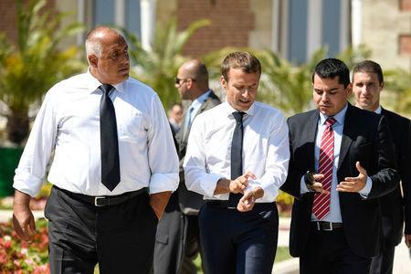 French President Emmanuel Macron (C) rolls up his sleeves as he walks along side Bulgarian Prime Minister Boyko Borissov (L) following a press conference at the Euxinograd Palace on the Black Sea coast just north of the town of Varna, Bulgaria, August 25, 2017. REUTERS/Bertrand Guay/Pool