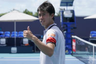 Kei Nishikori gives a thumbs up to his fans in the stands after defeating Aljaz Bedene of Slovenia, during the Miami Open tennis tournament, Saturday, March 27, 2021, in Miami Gardens, Fla. (AP Photo/Marta Lavandier)