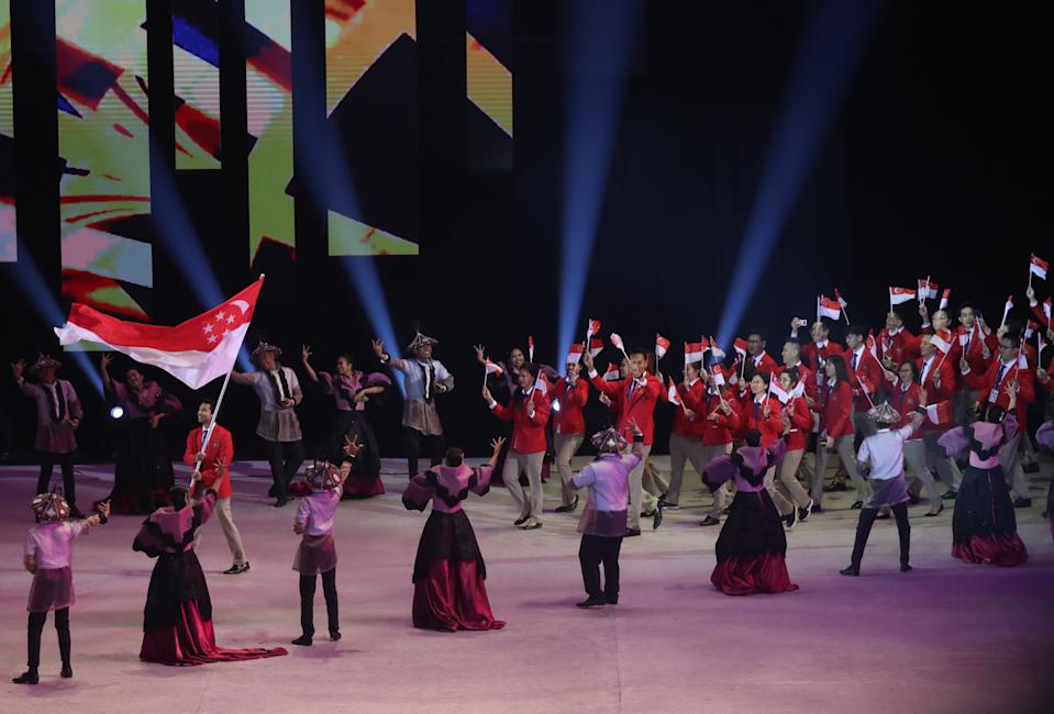 The Singapore contingent entering the Philippine Arena in Bocaue during the SEA Games Opening Ceremony on 30 November. (PHOTO: Reuters/Eloisa Lopez)