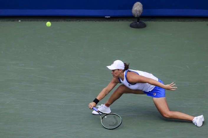 Ashleigh Barty, of Australia, reaches but is unable to return to Jil Teichmann, of Switzerland, during the women's single final of the Western & Southern Open tennis tournament Sunday, Aug. 22, 2021, in Mason, Ohio. (AP Photo/Aaron Doster)