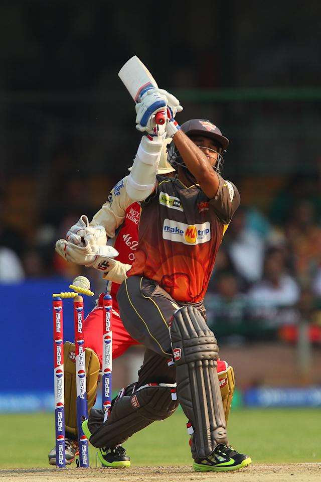 Parthiv Patel is bowled by Muttiah Muralitharan during match 9 of of the Pepsi Indian Premier League between The Royal Challengers Bangalore and The Sunrisers Hyderabad held at the M. Chinnaswamy Stadium, Bengaluru on the 9th April 2013. (BCCI)