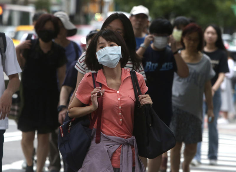 People wear face masks to protect against the spread of the coronavirus in Taipei, Taiwan, Saturday, June 6, 2020. (AP Photo/Chiang Ying-ying)