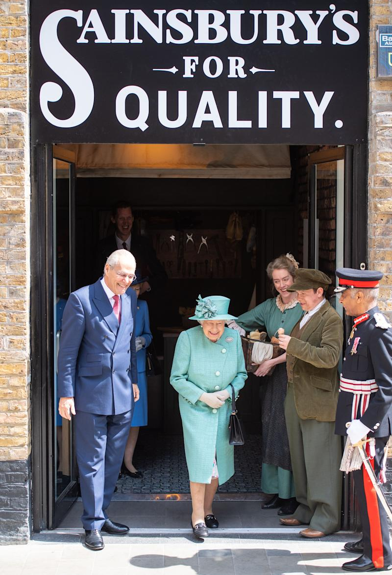 Queen Elizabeth II departs following a visit to Covent Garden, London, where she viewed a replica of one of the original Sainsbury's stores.