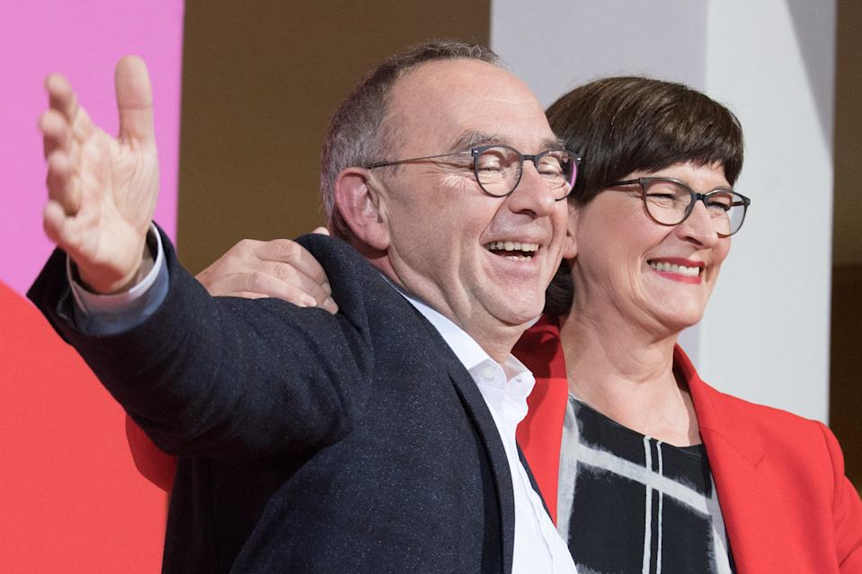 30 November 2019, Berlin: Norbert Walter-Borjans and Saskia Esken wave after the announcement of the result of the vote on the SPD chairmanship in the Willy Brandt House. Walter-Borjans and Esken have won the vote. The new leadership will be confirmed at the party conference on December 6. Photo: Jörg Carstensen/dpa (Photo by Jörg Carstensen/picture alliance via Getty Images)