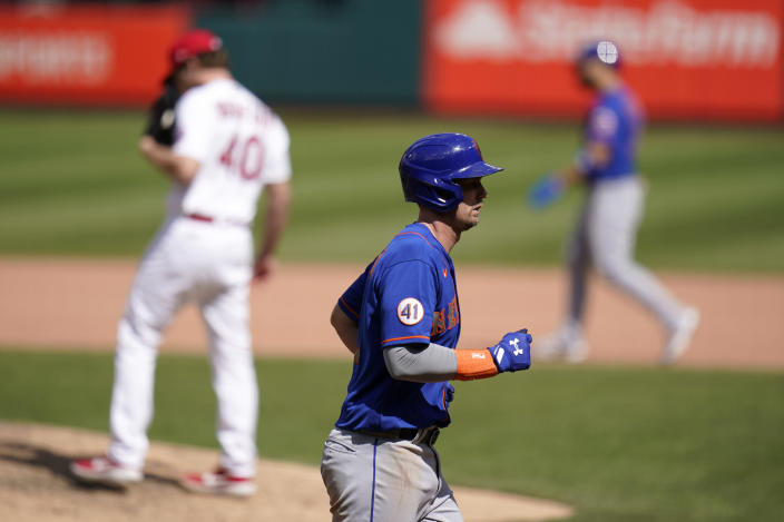 New York Mets' Jeff McNeil jogs in to score on a bases-loaded walk by St. Louis Cardinals starting pitcher Jake Woodford (40) during the eighth inning of a baseball game Thursday, May 6, 2021, in St. Louis. (AP Photo/Jeff Roberson)