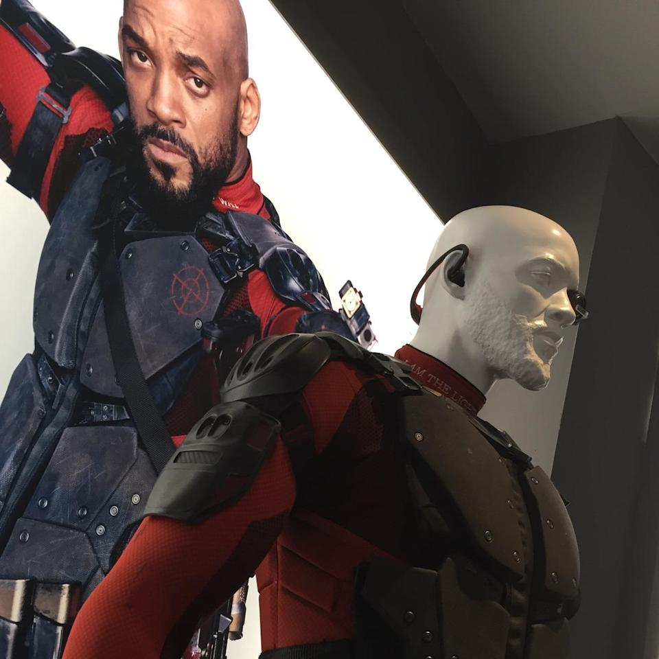 "<p>Will Smith's ace assassin is all armored up and wearing his cybernetic eyepiece for increased accuracy. His costume and guns are emblazoned with the words ""I am the Light… the Way.""</p>"