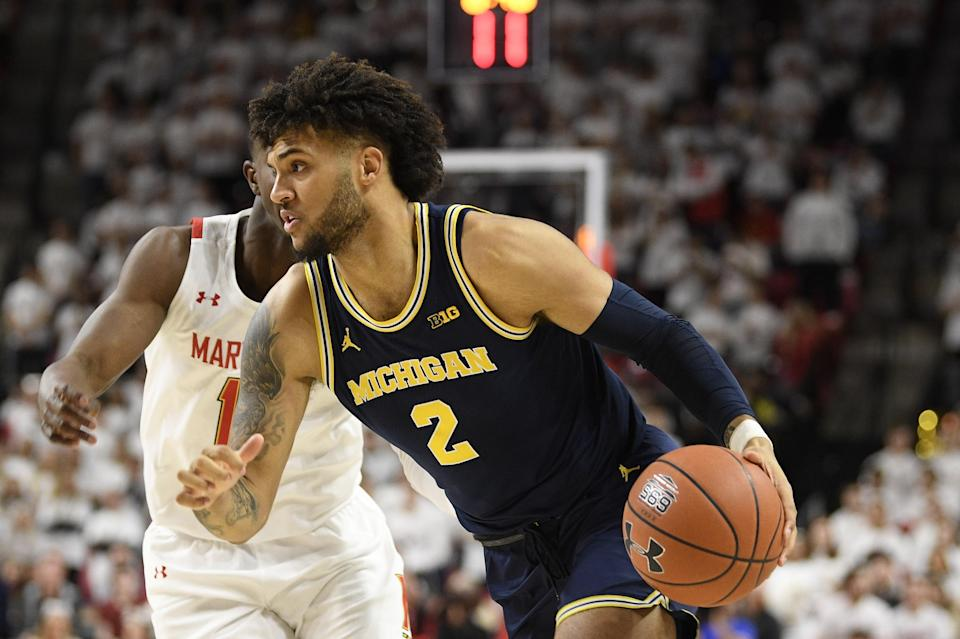 Michigan forward Isaiah Livers (2) dribbles the ball against Maryland guard Darryl Morsell, back, during the first half of an NCAA college basketball game, Sunday, March 8, 2020, in College Park, Md. (AP Photo/Nick Wass)