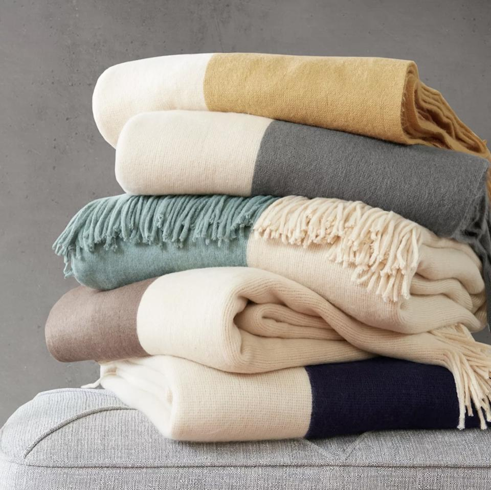 stack of color blocked throw blankets, target home decor items