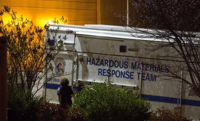 An official walks past a hazardous materials response team truck outside a mail sorting facility on April 16 in Hyattsville, Md.