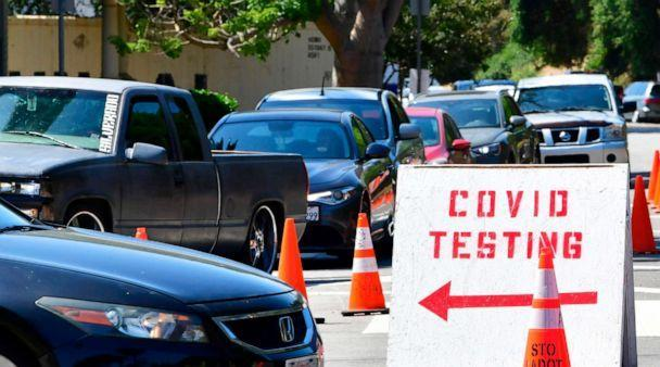 PHOTO: Traffic is directed at Dodger Stadium as people arrive for COVID-19 testing in Los Angeles, California, on June 30, 2020. (Frederic J. Brown/AFP via Getty Images)