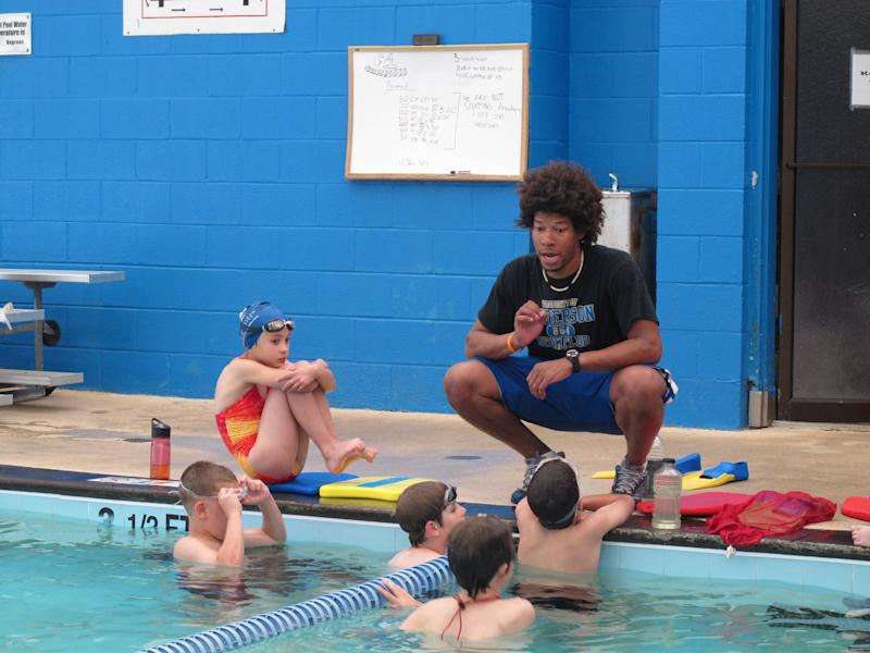 In this May 11, 2011 photo, swim team instructor Tariq Turner gives instructions to members of the Anderson Swim Team at the Sheppard Swim Center, in Anderson, S.C. The swim team is running the pool after city officials closed it to the public because of budget woes. (AP Photo/Jeffrey Collins)