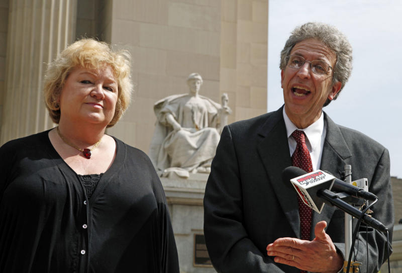 FILE  -  This June 6, 2011 file photo shows Betty Cockrum, left, president of Planned Parenthood of Indiana and attorney Ken Faulk speaking to reporters outside the Federal Courthouse in Indianapolis. Indiana will likely stop defending a law that stripped Medicaid funds from Planned Parenthood after the Supreme Court declined to hear the case Tuesday, May 28, 2013 an attorney who represents the nation's largest abortion provider said. (AP Photo/Michael Conroy, FILE)