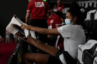 United States' Jordan Thompson treats her injured foot during the women's volleyball preliminary round pool B match between United States and Italy at the 2020 Summer Olympics, Monday, Aug. 2, 2021, in Tokyo, Japan. (AP Photo/Frank Augstein)