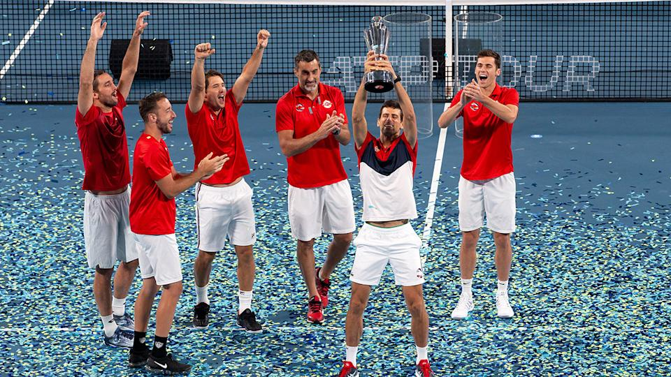 Novak Djokovic and Team Serbia, pictured here lifting the ATP Cup trophy.
