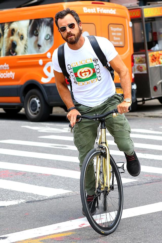 <p>Jennifer Aniston's hubby was just another normal guy, biking through New York City. The only way you could tell he was a movie star was by his Gucci T-shirt. (Photo: BACKGRID) </p>